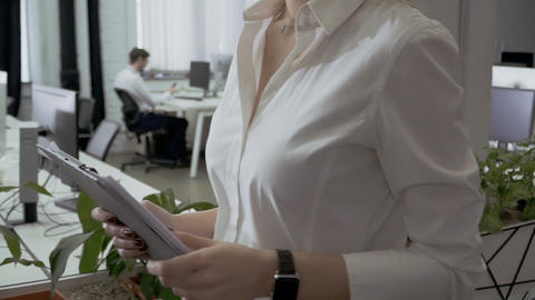 The man pushes woman in shoulder during she's walking in the office Archivo