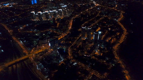 Vertical top down aerial view of night panorama of a big city Footage