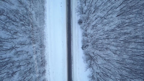 Aerial view on winter forest road. Scenic winter landscape Live Action