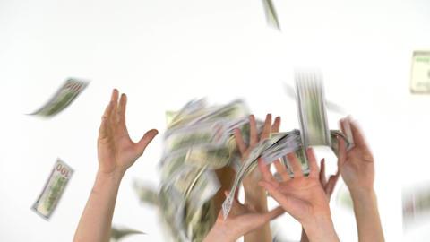 Many hands catch falling US dollars Archivo
