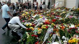 People place flowers at Dutch embassy in Kyiv GIF