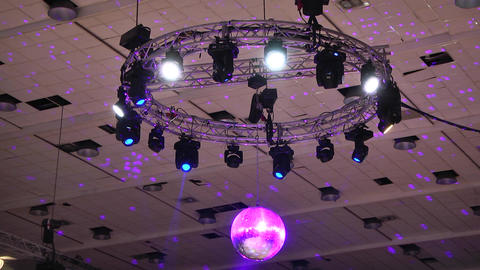 Strobes attached to the ceiling moving and give light In the center is a silver Footage