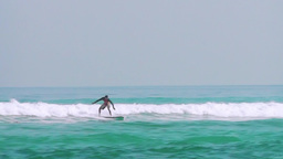 Beginner Surfer Is Learning To Slide On A Wave stock footage
