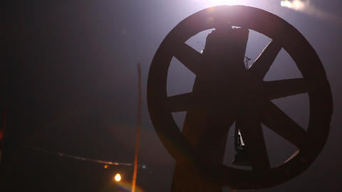 Silhouette of Antic wood wheel Live Action