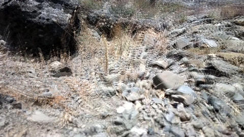 walk on rocks in mountains a dangerous transition Footage