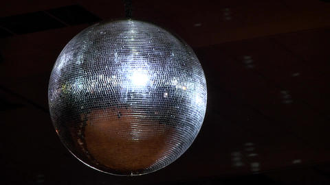 Disco party atmosphere A silver disco ball colored light diffuses - 037 (2) Footage