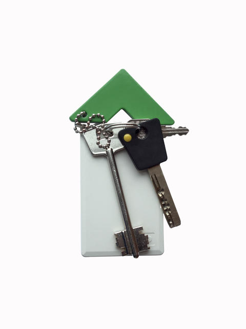 House stylized of access cards and keychain on a white backgroun フォト