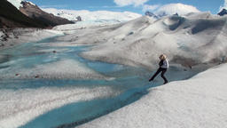 Girl in snowy mountains on glacier melting in Antarctica Footage