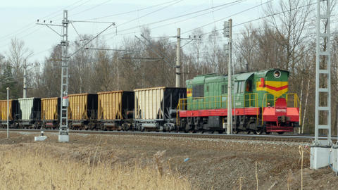 Cargo diesel locomotive with railcar in motion Footage