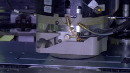 Cutting holes perforation stamping of metal sheets on industrial CNC machine Footage