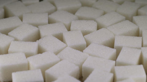 Shugar cubes close up on rotating table Stock Video Footage