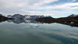 Sea mountains and large icebergs reflecting water Footage