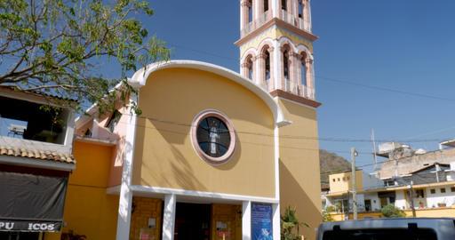 Tilt up of the Parroquia de la Santa Cruz in Puerto Vallarta, Mexico revealing Archivo