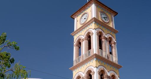 Medium shot of the clock tower on top of the Parroquia de la Santa Cruz in ビデオ