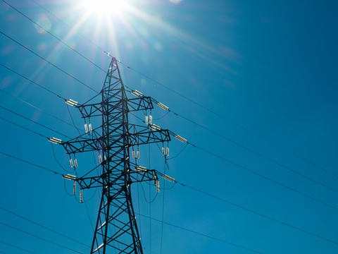 High voltage power line on blue sky background Photo