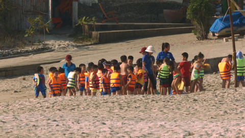 Educators Organize Leisure for Children on Beach Footage