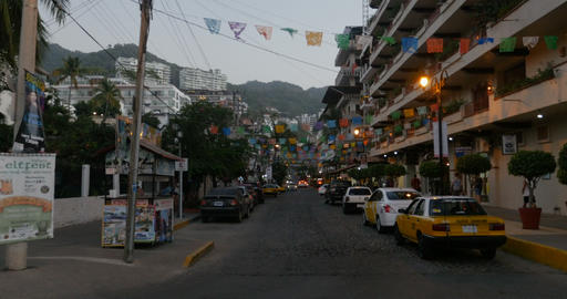 PUERTO VALLARTA, MEXICO - CIRCA MARCH 2018 - Banners, taxi cabs, and people at Footage