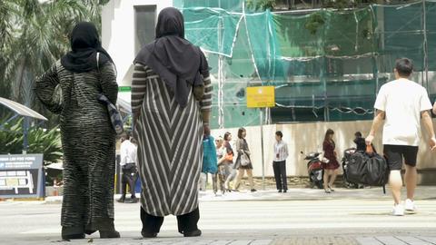 KUALA LUMPUR, MALAYSIA - CIRCA FEBRUARY 2018 - Muslim women in burqas waiting to Footage