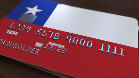 Plastic bank card featuring flag of Chile. Chilean banking system conceptual Live Action
