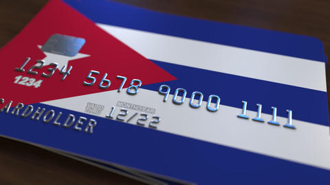 Plastic bank card featuring flag of Cuba. Cuban banking system conceptual Live Action