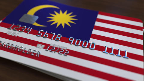 Plastic bank card featuring flag of Malaysia. Malaysian banking system Footage