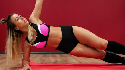 Two beautiful sports girls perform an active fat-burning workout jumping like a Footage