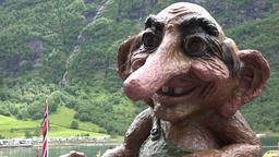 Norway Geiranger troll with grotesque face and long nose in the fjord Footage