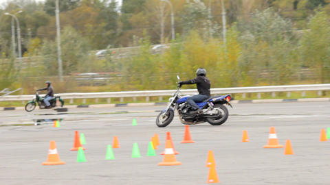 Motorcycle events, motorcycle rider at speed runs a line of road cones Footage