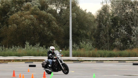 Fast motorcycle rider rides on the platform for the training of driving Footage