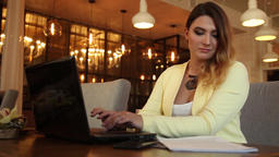 Business woman in business clothes working with documents using a mobile Footage