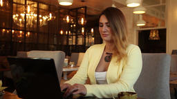 Business woman in business clothes typing on mobile computer sitting at table Footage