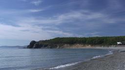 Sea waves surf on stony rocks beach. Japan Sea Footage