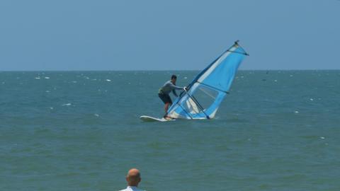 Guy Does Sport Surfing in Ocean Merging with Sky Footage