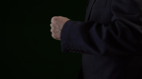 Close up of hurry businessman in suit runing, slow motion. Low key dark Footage