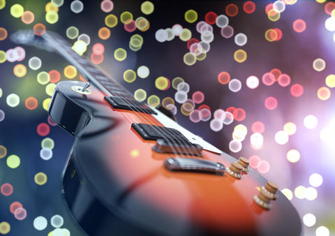 Close up shot of a guitar, over blured lights background Fotografía