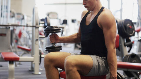 young man with dumbbells in gym Footage