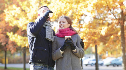 Smiling Couple With Coffee Cups In Autumn Park stock footage