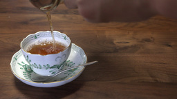 4K pouring hot tea into a tea cup Footage