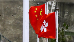 Flags of China and Hong Kong in the wind Videos de Stock