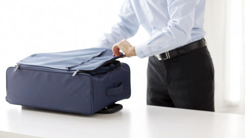 businessman packing clothes into travel bag Footage