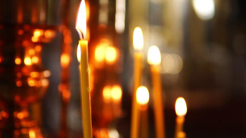 One burning candle in focus, the Orthodox Church Footage