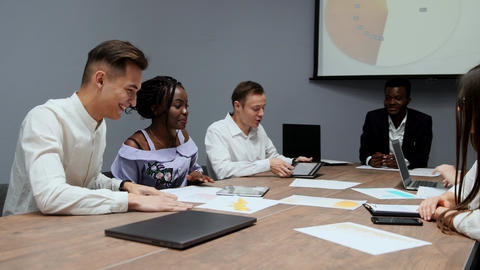 A group of creative multi-ethnic managers disassemble at the meeting of the Footage