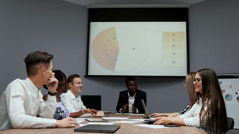 The Board of Directors reviews the chart on the projector... Stock Video Footage