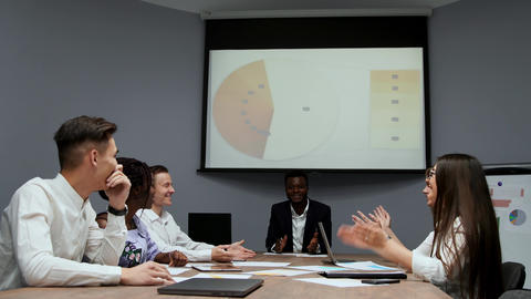 The Board of Directors reviews the chart on the projector and discusses possible Footage