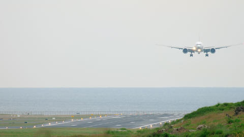 Widebody aircraft approaching over ocean Live Action