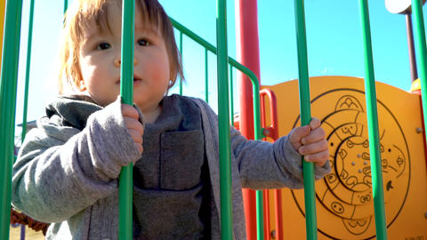 Toddler boy playing on the playground Footage
