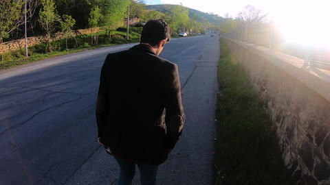 Young Man Walking Along Street Live Action