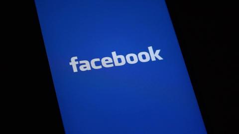 FACEBOOK logo on iphone screen GIF
