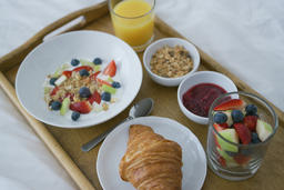 Healthy assorted breakfast served on tray フォト