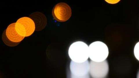 Beautiful bokeh luminous headlights machines Footage